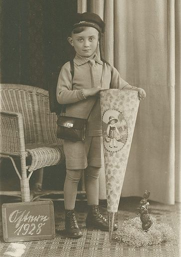 German Boy on his first day at school with a traditional Schultute cone full of treats. 1928