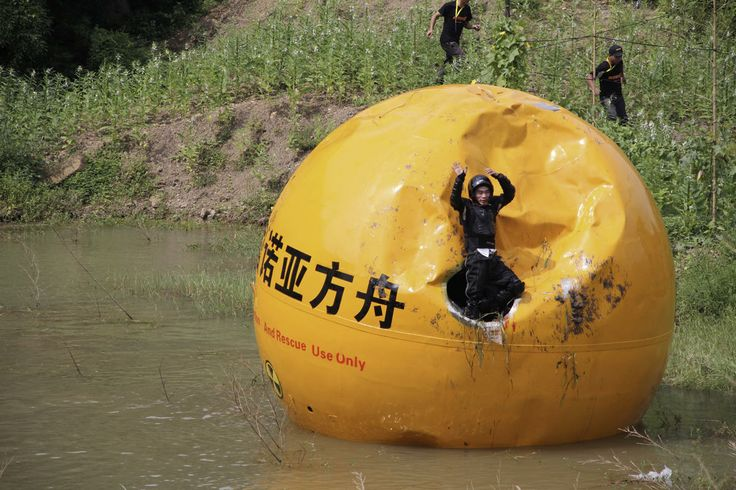 "A Chinese inventor, Yang Zongfu celebrates on his six-ton ball container named ""Noah's Ark of China"" after he succeeds in a series of tests of the vessel in Yiwu, Zhejiang province, August 6, 2012."