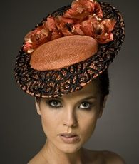 I love the pumpkin color of this one, and the whole piece is wonderful.  Julie Anne Lucas Millinery.