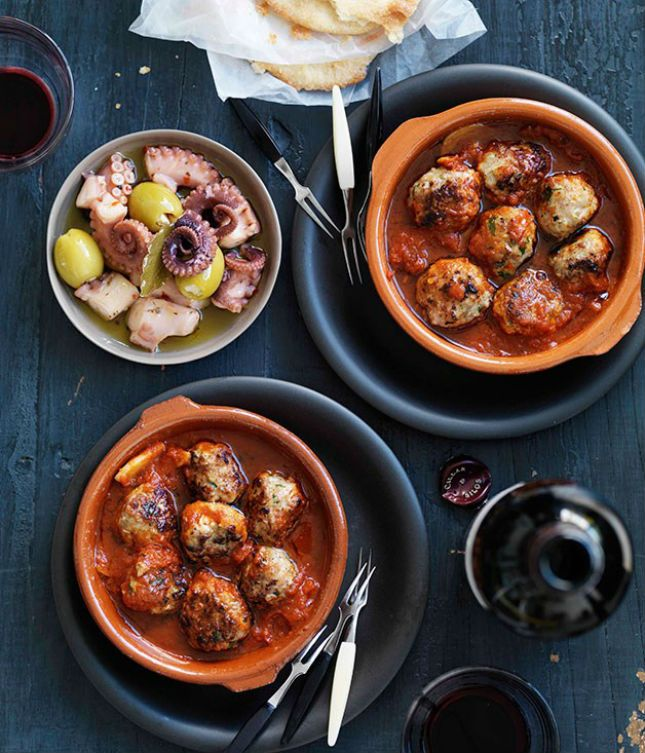 Albondigas With Spicy Tomato Sauce: Small bites of savory delights — meatballs with a hint of spice, drenched in tomato sauce. Let dinner guests take one (or two) and pass them on.