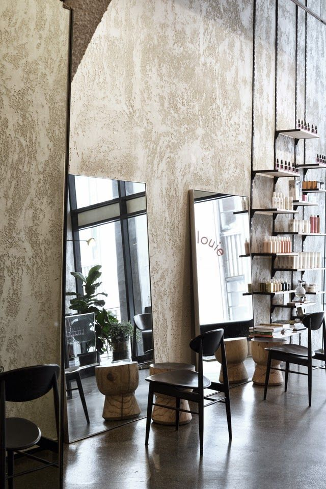 Bsolutely love this mirror style and wall texture for cutting stations. Industrial shelving in background is a good wau to incorporate gear and products. Maybe one narrow column every 2x chairs.