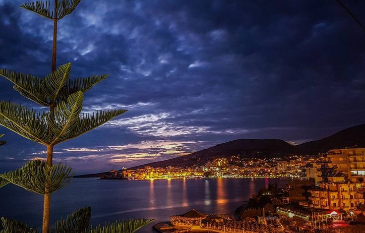 Beautiful evening in Sarande.  Warm weather, home made carbonara pasta and Albanian wine 🍷🍾🍷 We wish you a great evening too!  Picture from the balcony of @travelinggreek