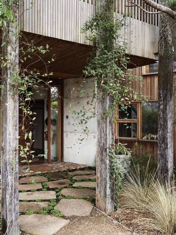 Front entry. Solid timber pillars salvaged from a wharf in WA. Garden by DMS Landscapes. Photo – Eve Wilson, production – Lucy Feagins / The Design Files.