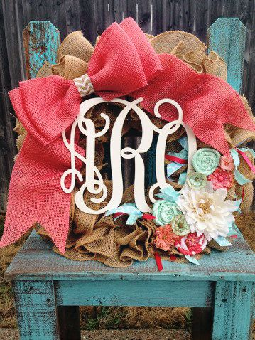 I love this!!! Coral and mint monogrammed baby girl/boy burlap wreath.www.peaceloveburlap.etsy.com