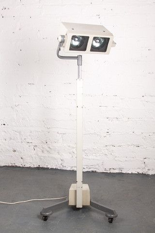 1960's medical floor lamp, on wheeled base. In full working order.  If you like this check out our shop http://industrialthings.com/