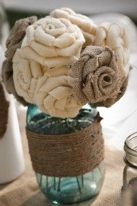 Burlap bouquet - easy to make, and it lasts forever! Rosettes could also be used for a more masculine boutonniere. Would be cute on tables w/ lace