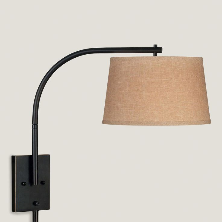 Featuring A Butterscotch Hued Tapered Drum Shade And An Understated Streamlined Swing Arm