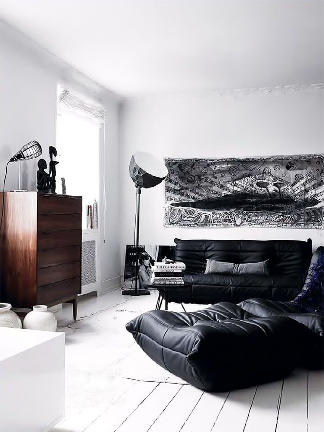 Black Sectional Living Room Decor: Comfortable Living Room With Black Sofa And Puff