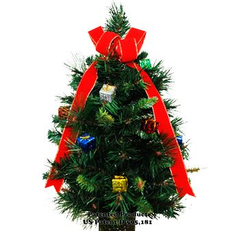 "Stay-In-The-Vase® Tree (TR1156) A patented, one-of-a-kind Christmas tree with purple, yellow, blue, green, red, and silver Christmas presents and a red bow designed for ground vases. Approximately 24"" tall. Patent # D595,181"