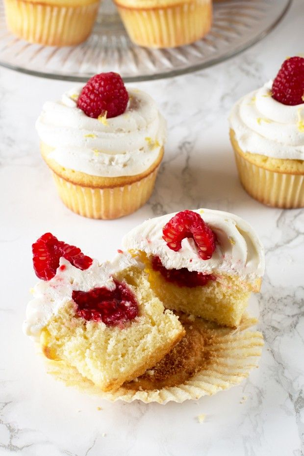 Lemon Raspberry-Filled Cupcakes with White Chocolate Buttercream Frosting | cakenknife.com