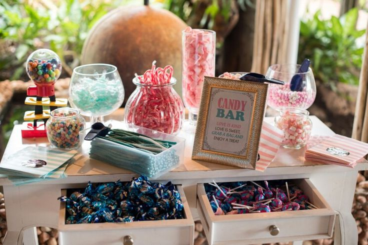 Candy table, pink and blue sweets. Candy bars are definitely a hit