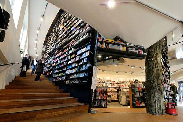 This beautifully designed space has surprising shapes, cleverly constructed nooks and crannies and even a tree or two. The American Book Center, Amsterdam, the Netherlands