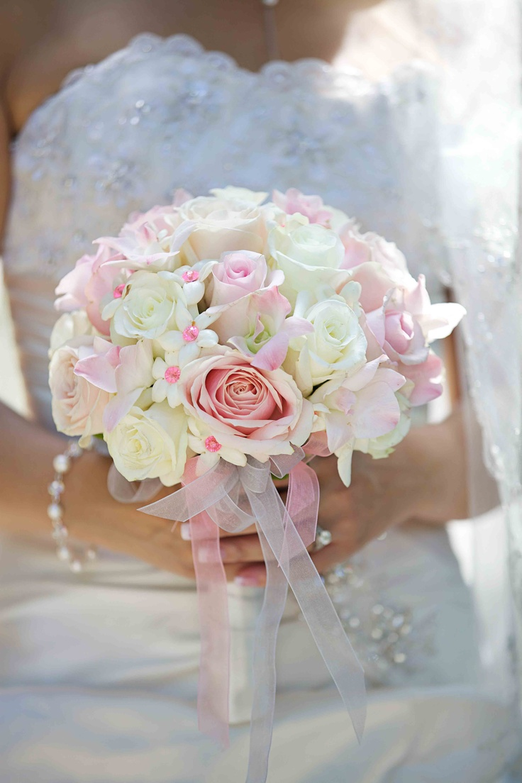 Pretty in pink bridal bouquet - Sweet Akito (light pink) roses, Eskimo roses, white hydrangea, and white stephanotis with pink jewelled centers. Stems ribbon wrapped in two shades of pink organza ribbon. (Photo courtesy of Andras Schram Photography)