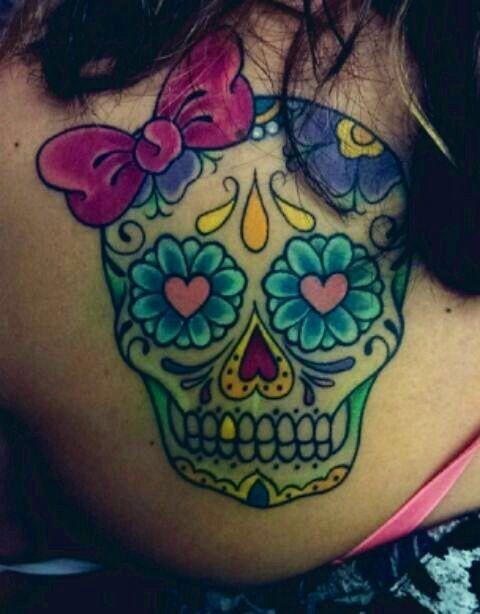 You can girlie them up. | 41 Amazing Sugar Skull Tattoos To Celebrate Día De Los Muertos