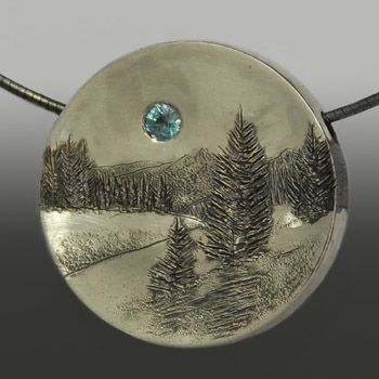 Wolfgang Vaatz: , Pendant in sterling silver and 3.5mm natural blue zirconia. Pendant only, neckwire not included.