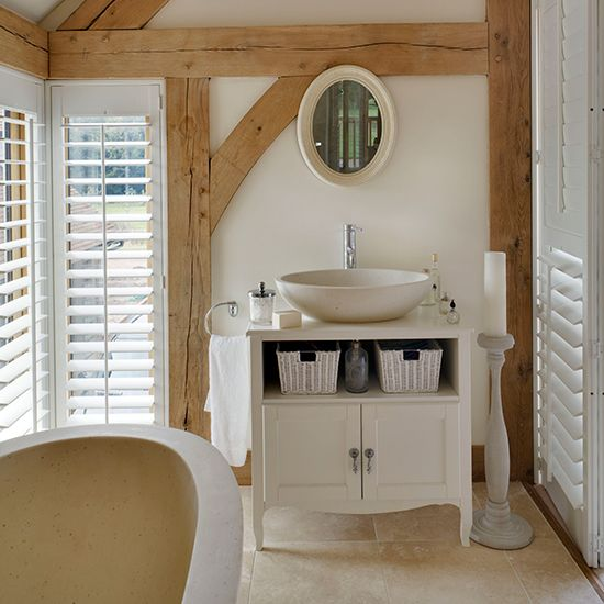 By repurposing a vintage cabinet, a joiner or plumber can create a freestanding basin unit that's perfectly suited to a country bathroom. Sit a bowl-style basin on top, and make use of the open shelf for pull-out baskets.