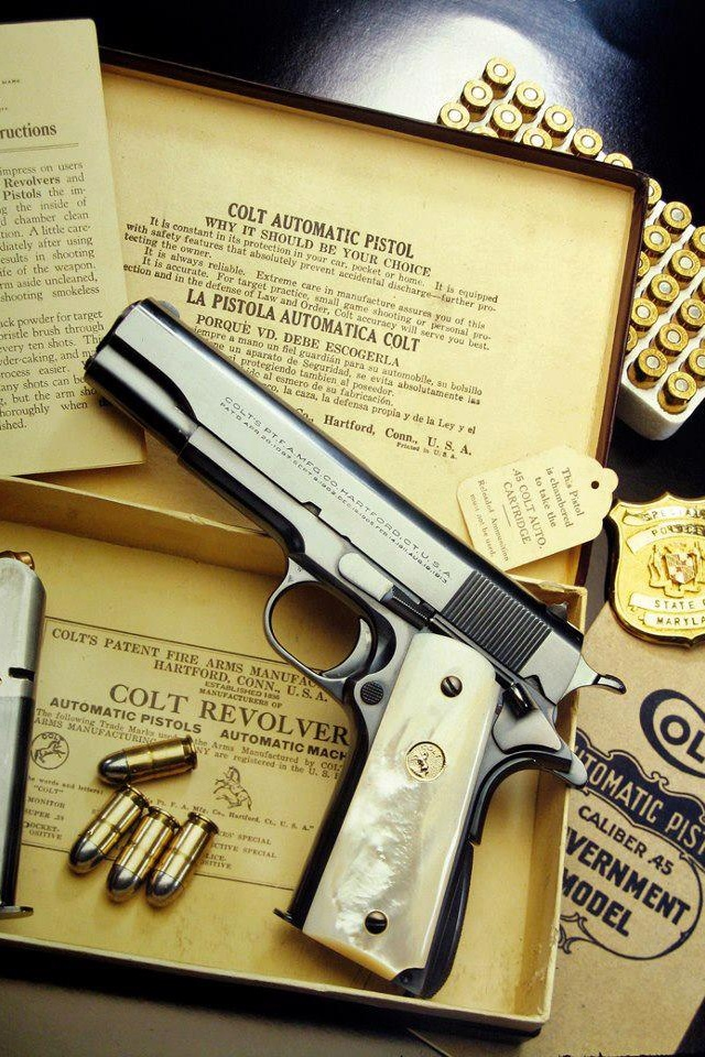 Colt 1911 .45  Pearl grip.  I will have one!!! Find our speedloader now!  http://www.amazon.com/shops/raeind