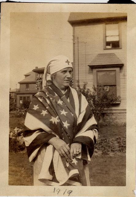 Red Cross Volunteer and US Flag - Vintage by Tobyotter, via Flickr