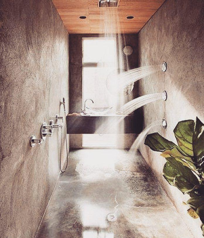 Multiple shower heads on multiple walls