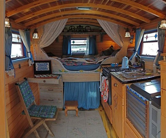 how cute and cozy is the inside of this tiny home wagon? love it!