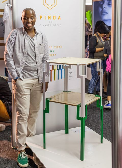 Siyande Mbele showcases his Ndebele, Venda and Zulu inspired PINDA stackable table  Credit: Sunday Times