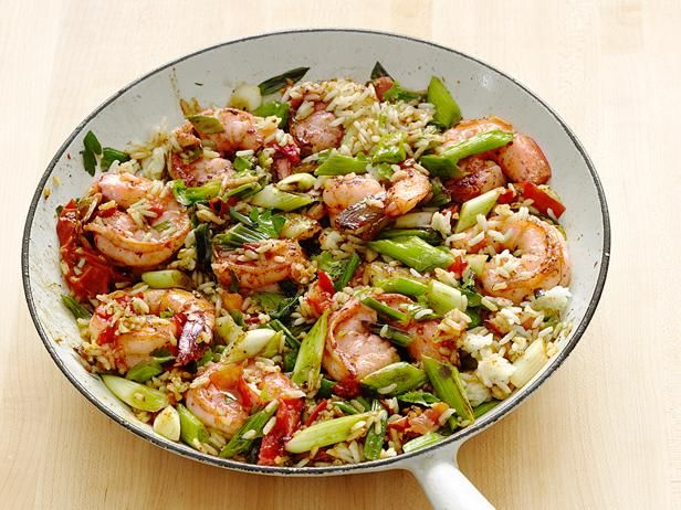 Healthy. Super fast (just 20 minutes). All-in-one. Full of flavor. #FNMag's Cajun Shrimp and Rice recipe hits all the high notes, making it a must-have addition to your weeknight repertoire. #RecipeOfTheDayFood Network, Rice Recipes, Brown Rice, Maine Dishes, Cajun Shrimp, Foodnetwork, Summer Dinner, Dinner Tonight, Weeknight Meals