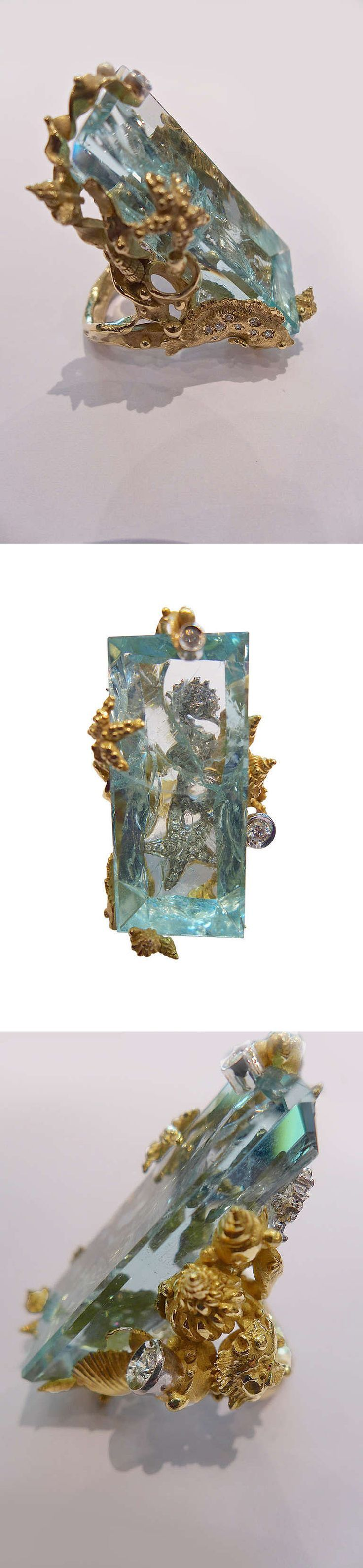 Yellow gold Massimo Izzo ring representing sea life, aquamarine and diamonds. A spectacular, unique and exceptional Massimo Izzo ring representing sea life. An enormous rectangular aquamarine decorated behind the transparency with a sea star, a seahorse and several shells set with diamonds. C 2004. [This is definitely a statement piece. While I would not wear it myself, it's so over the top and unique, I had to include it.]