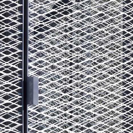 Double layer metal mesh screen. Veterinarian N House by Eureka and Atelier Chocolate. #stairtowerideas