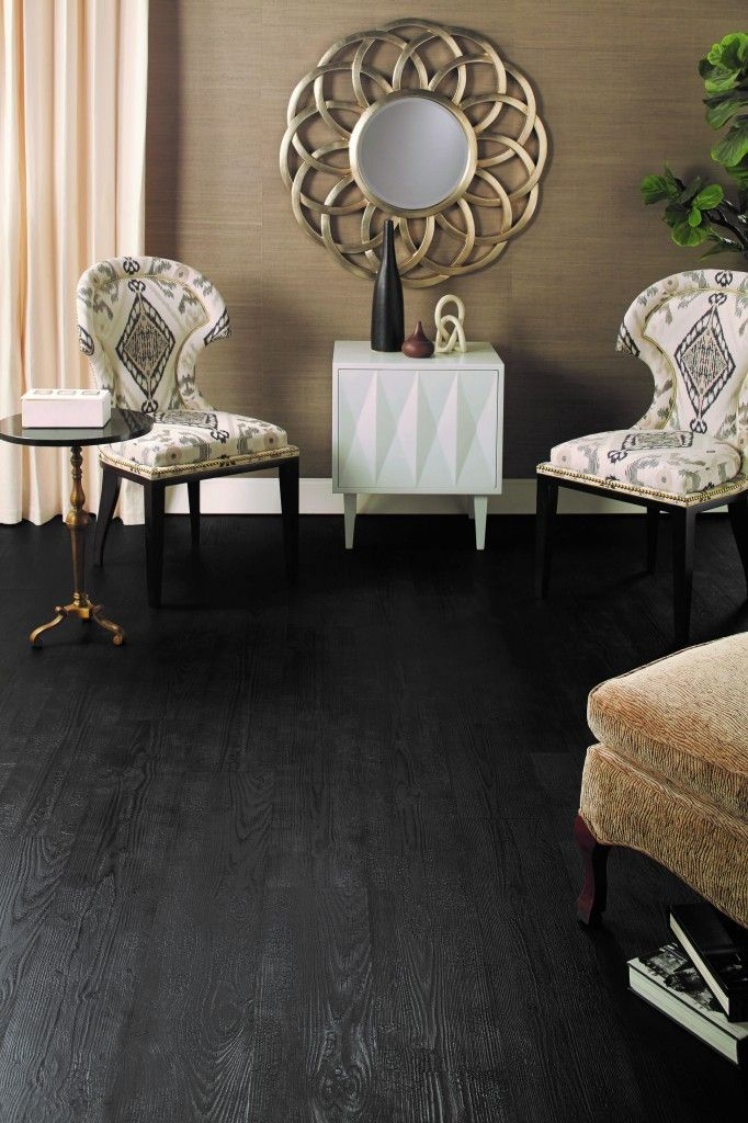 One of the most intriguing trends in premium hardwood flooring these days is a technique called charring. Here's how Quick-Step incorporated this trend into the new Tuxedo Pine laminate floor.