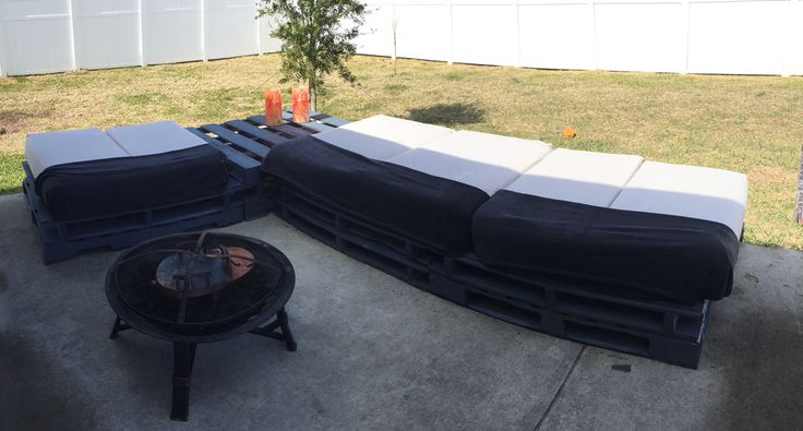 Patio sectional, 9 total pallets. 2 on the end stacked, 3 stacked in the corner to create a table area, and 4 stacked 2 high to create the long end. Placed 11/36 board over the tops to create a sturdier seating area. Cushions we made with cloth and blankets for warmth.