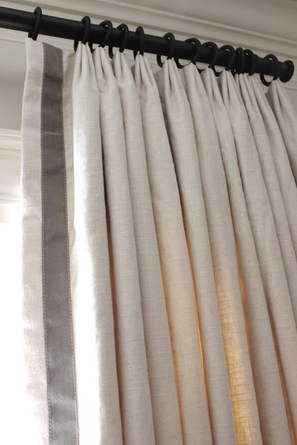 a simple pleat at the top....lined and interlined to give the light fabric some weight. Contrast band and the rings were hand sewn on.