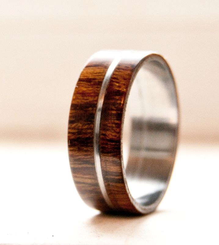 Men's wood wedding band with metal inlay. Available in: titanium, silver, or gold See more here: http://www.stagheaddesigns.com/products/mens-wood-wedding-band-with-metal-inlay