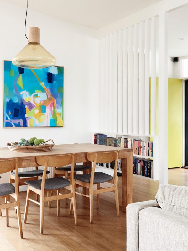 Dining Area. Czechoslovakian pendant from Brokis Muffin. Artwork by Noni Drew Art. Dining table by Sandane Sorrento, dining chairs from Grandfathers Axe. Fruit bowl by Carga Seminyak. Photo – Eve Wilson. Production – Lucy Feagins / The Design Files.