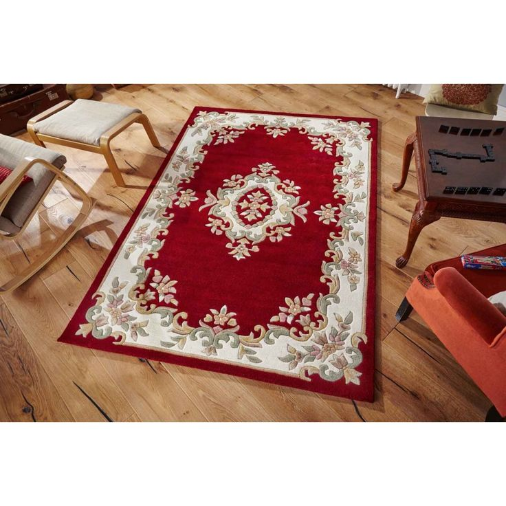 Royal Red Traditional Rug By Oriental Weavers Add a splash of colour to your home decor with this Royal Red Traditional Rug.This handmade area rug is made from pure virgin wool pile. This hand-tufted rug features a traditional pattern on a vibrant red background. #woolrugs #traditionalrugs #redtraditionalrugs #handmaderugs #borderedrugs #floralrugs #floralredrugs #floraltraditionalrugs