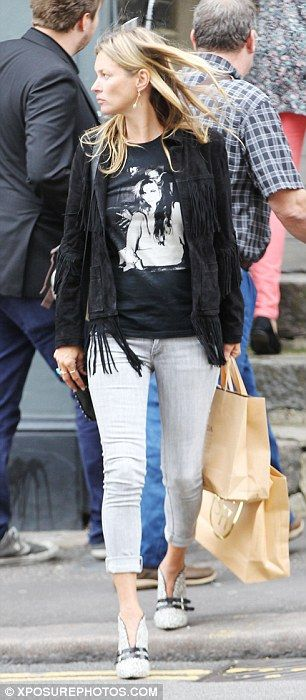 Rocking it: The supermodel looked incredibly stylish in her skinny jeans and T-shirt combo...