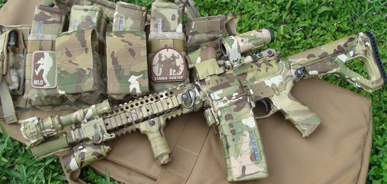 Dipped AR in Multicam with AimPoint micro, UBR stock, magnifier