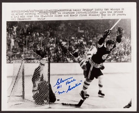 A photograph of the famous Bobby Orr Stanley Cup winning goal, signed by the goalkeeper who let in that goal, Glenn Hall.