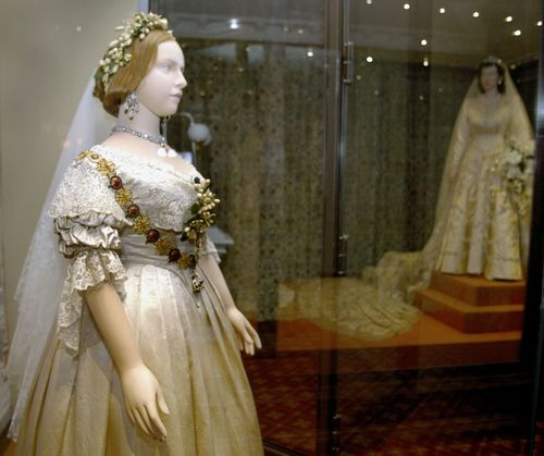 womenshistory:  Wedding gowns for Queen Victoria and Queen Elizabeth II are shown in a 2002 London exhibition, A Century of Queens' Wedding Dresses. Getty Images / Sion Touhig