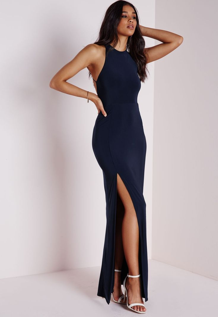 Slip into this slinky number this season for a seriously seductive look. With chic split to the front and crossover to reverse this navy maxi dress is a dream. Style with stunning silver strappy heels and metallic clutch for a luxe look. ...