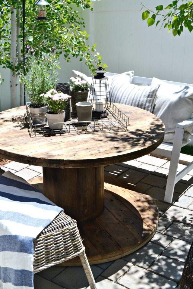 Small Patio On A Budget | Simple DIY Projects and inexpensive and thrifted outdoor furniture create a beautiful, functional, small patio space. All on a tight budget. | MyFabulessLife.com
