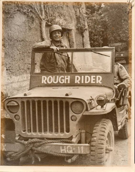"Brigadier General Theodore Roosevelt, Jr. and his ""Rough Rider"" Willys Jeep. The jeep is in the museum at Sainte-Mère-Eglise.:"