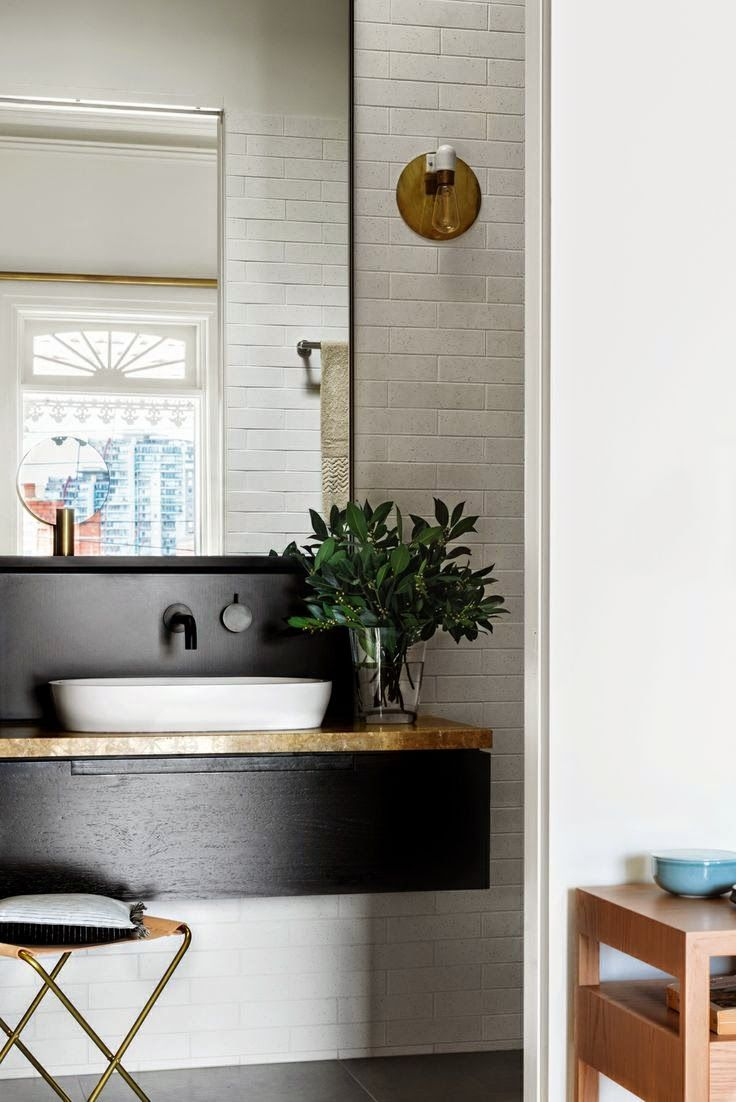 Black and white guest bathroom.  The faucet is so simple and nice.Love the brass lamp and the green leaves. ChicDecó: | A scandinavian inspired renovation