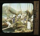 Boats carrying seaweed in Pusan harbor