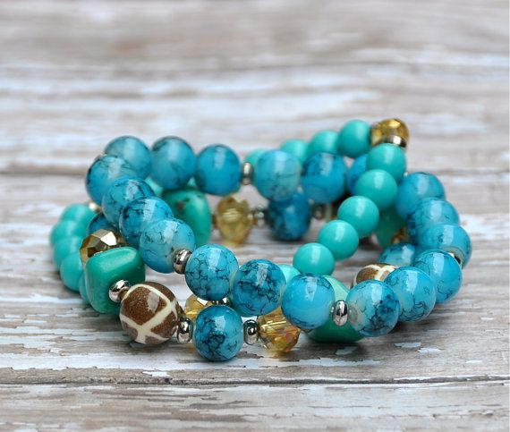 Aqua Blue Stretch Beaded Bracelets / Set of 3 by BeadRustic, $25.00 Three intertwined aqua blue beaded bracelets for easy styling. Shades of blue, faceted amber & giraffe beads. Set of 3.