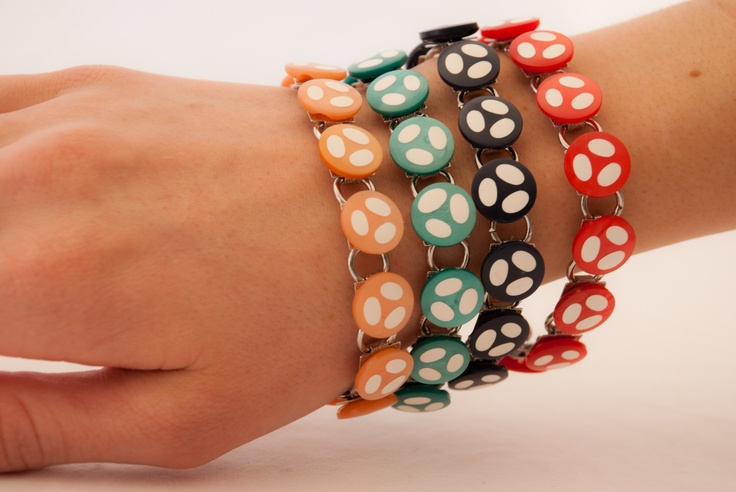 """Bracelets with """"cat paw"""" buttons from the 1960's."""