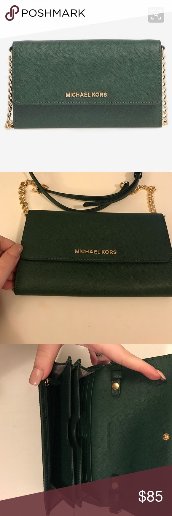 NWOT Michael Kors Large Phone Travel Crossbody Brand new never used. Purchased from Nordstrom around Christmas time. The color is moss green. Gold hardware. Card and phone slots. Detachable strap.  SKU: 8539795 Made of saffiano leather. Snap closure. Adjustable crossbody strap with chain detail. Exterior back slip pocket. Signature logo hardware detail in front. Lined interior. Interior zip pocket. Measurements: Bottom Width: 7 in Depth: 1 1⁄2 in Height: 5 in Strap Length: 50 in Strap Drop…