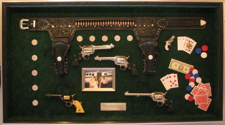 "Framed by Constance Crawford in Greensboro, NC. This is a 4"" deep shadowbox containing five collectable pistols, a tooled leather and silver western holster, silver dollars, a framed family photo, and a poker game, mounted on a green suede mat to resemble a poker table. And yes, that IS a real $100 bill."