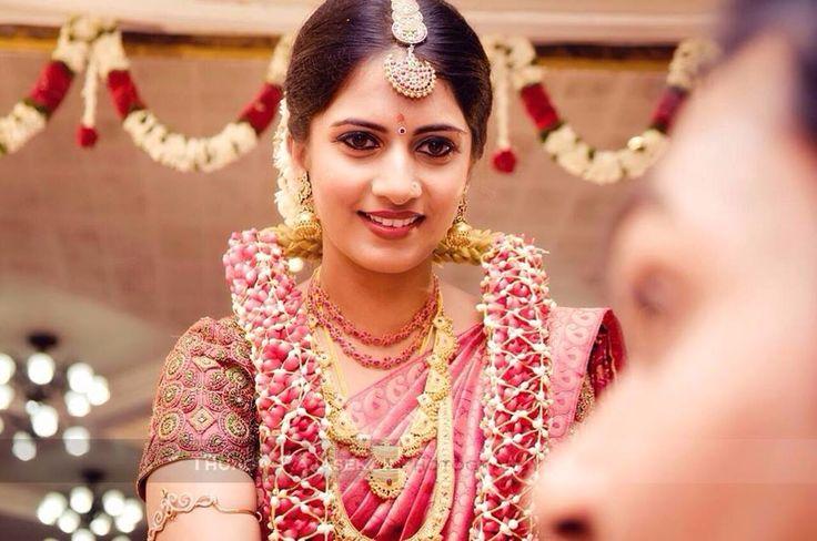 South Indian bride. Temple jewelry. Jhumkis.Pink silk kanchipuram sari.Braid with fresh jasmine flowers. Tamil bride. Telugu bride. Kannada bride. Hindu bride. Malayalee bride.Kerala bride.South Indian wedding. Thaali.