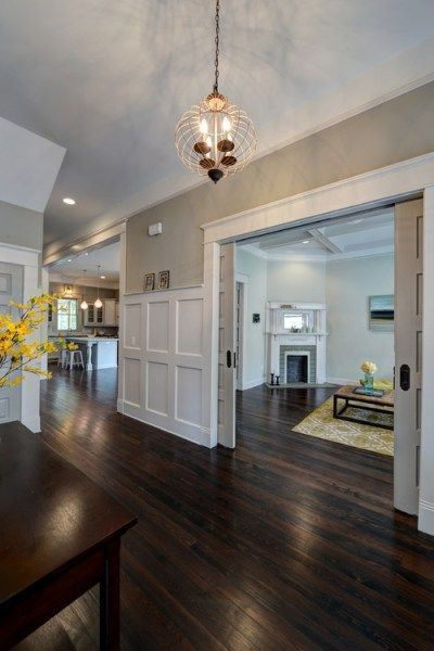 mindful gray by sherwin williams is the darker version of repose gray shown in hallway with white color on wainscoting floor color
