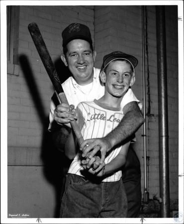 Image: di27604 - Larry Corman coaches Ronald Akins to hit a homer - student at Redwood School
